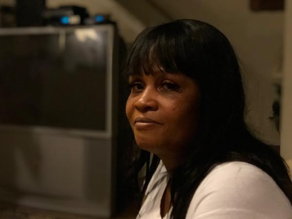 Lakeker Bright sits in her family's living room, where her 18-year-old son Jamie was shot and killed in July. Bright says it kills her that she'll never be able to see her son grow up.