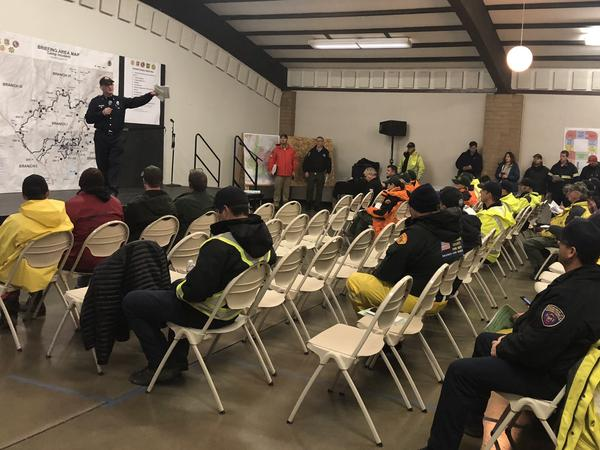 Emergency crews debrief ahead of Friday's fire search mission from the Camp Fire command post in Chico, Calif. Crews were warned about mud and debris slides along destroyed area.