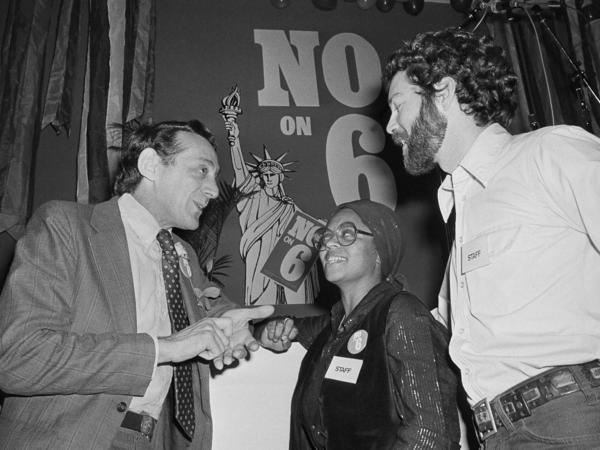 San Francisco Supervisor Harvey Milk, left, who was openly gay, talks with Gwenn Craig and Bill Kraus, co-coordinators of the San Francisco No on Prop 6 program in San Francisco on Nov. 7, 1978. Prop 6, which would have banned gay and lesbian teachers, was defeated.