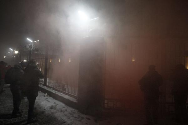 The Russian embassy in Kiev is seen covered in smoke during a protest of activists, following an incident in the Black Sea near the Crimea annexed by Russia, in which three Ukrainian naval vessels were seized by a Russian border guard vessels.