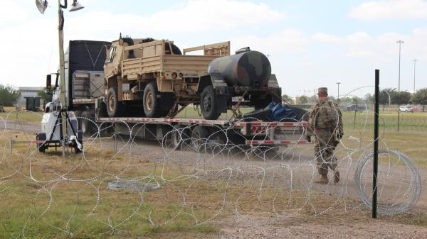 A military vehicle enters an encampment in Donna, Texas, just inside the U.S. border with Mexico.