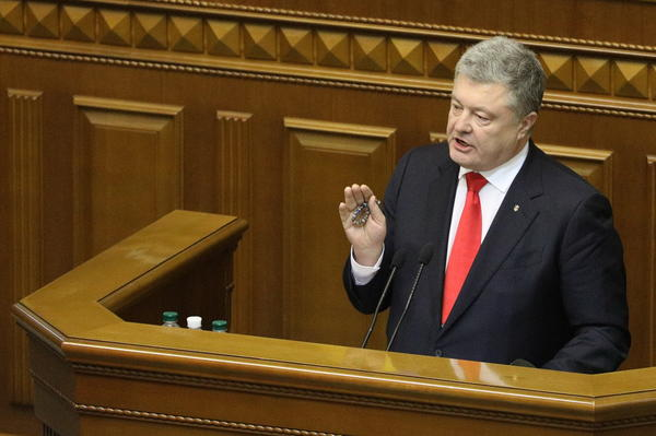 Ukrainian President Petro Poroshenko gestures during a parliament session in Kiev on Monday.
