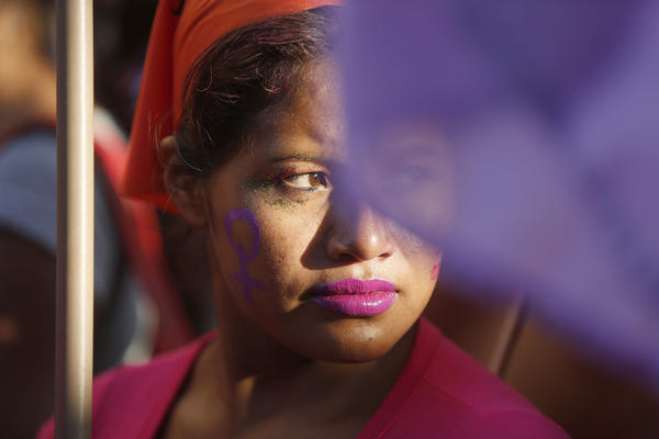 A woman attends a march marking the International Day for the Elimination of Violence Against Women in Asuncion, Paraguay, on November 25. Paraguay is one of the Latin American countries that has passed a law categorizing femicide — killing a woman because of her gender — as a specific crime.