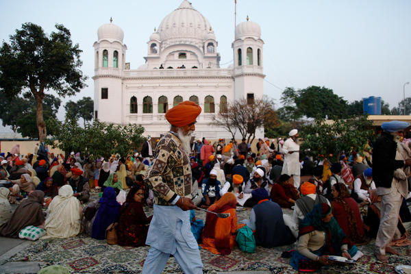 Sikh worshippers gather outside their holiest site, the Gurdwara Darbar Sahib Kartarpur. It is believed to be the place where the founder of Sikhism, Guru Nanak, died in the 16th century. In a rare goodwill gesture this week, India and Pakistan broke ground on a corridor that will allow visa-free travel for Indian Sikhs to the holy site.