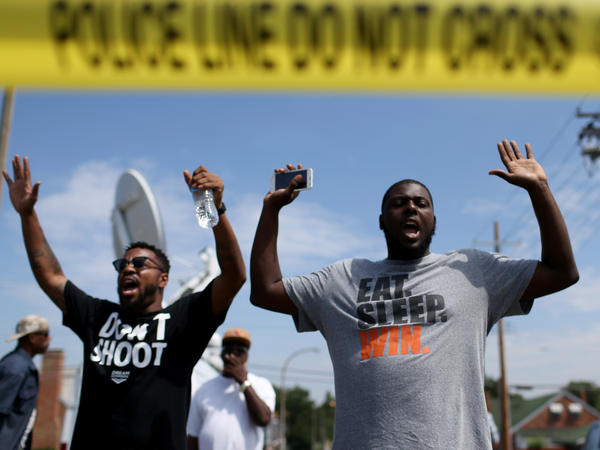 "The shooting of Michael Brown in Ferguson, Mo., also led to a series of protests. Many of them, like this protest on Aug. 19, featured people raising their arms and chanting, ""Hands up, don't shoot."" But interactions between police and protesters were more tense — and sometimes violent — than in New York."