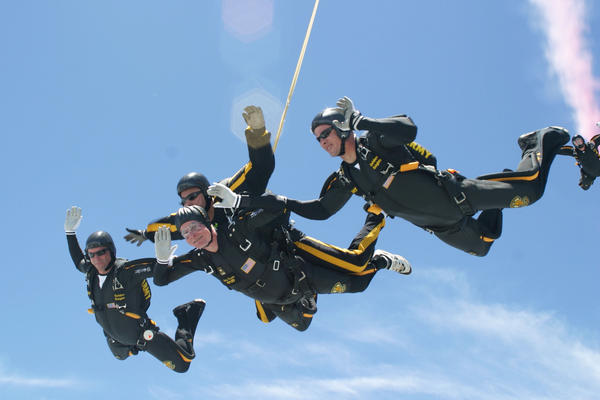 Bush (center bottom) performs a tandem parachute jump with Army Golden Knight Sgt. Bryan Schnell in 2004 over the George H.W. Bush Presidential Library and Museum in College Station, Texas. Bush made two jumps to celebrate his 80th birthday.