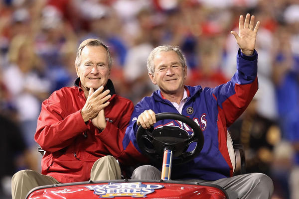 Father and son wave to the crowd before the Texas Rangers host the San Francisco Giants in Game 4 of the 2010 World Series at Rangers Ballpark in Arlington, Texas.
