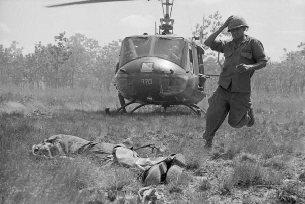 In November 1965, Joe Galloway snapped this photo of his childhood friend Vince Cantu during the Battle of the Ia Drang Valley, without realizing who was pictured. Vince was rushing to pick up the body of American soldier in Plei Me, South Vietnam, to transport him home. The photo would ultimately run in several magazines.