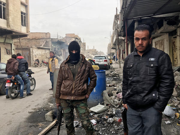 Fighters from Iraq's popular mobilization forces — paramilitary units nominally under Iraqi government control. Mobilized by Shiite religious leaders to fight ISIS, they are manning checkpoints in Mosul's Old City until local police can take over.