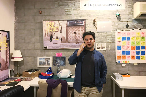 "Filmmaker Abdulrahman Khawj, 30, founder of the Cinepoetics Production Company, talks on the phone in his office in Jeddah. ""I no longer want to flee the country and go to New York,"" he says. ""Here we're doing something very new."""