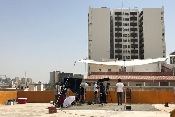 A crew led by a female director shoots a short film on the roof of a Jeddah apartment building.