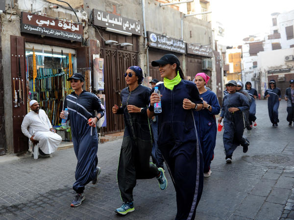 Saudi women jog in the streets of Jeddah in March. The government is encouraging greater participation by women in sports.