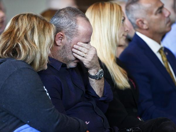 Fred Guttenberg, whose daughter, Jaime, was killed in the Parkland, Florida, school shooting last February, cries while his wife Jennifer comforts him during a state commission meeting Thursday, Nov. 15, 2018.