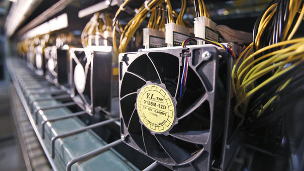 Fans used to cool bitcoin data miners are hooked up in a bitcoin data center in Virginia Beach, Va., in February.