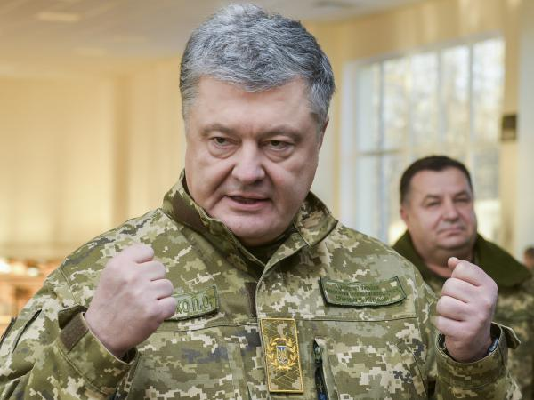 Ukrainian President Petro Poroshenko speaks to soldiers during a visit to a military base in Chernihiv region, Ukraine, on Wednesday. Russia and Ukraine traded blame after Russian border guards on Sunday opened fire on three Ukrainian navy vessels and eventually seized them and their crews. The incident put the two countries on a war footing and raised international concern.
