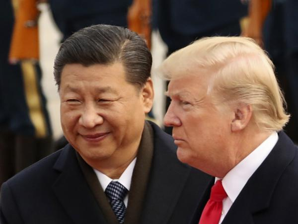 President Trump and Chinese President Xi Jinping participate in a welcome ceremony at the Great Hall of the People in Beijing last November.