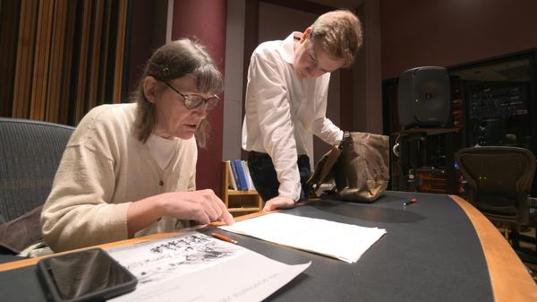 "Professor Patricia Hall and graduate student Joshua DeVries discuss the music manuscript for ""The Most Beautiful Time Of Life"" at University of Michigan."