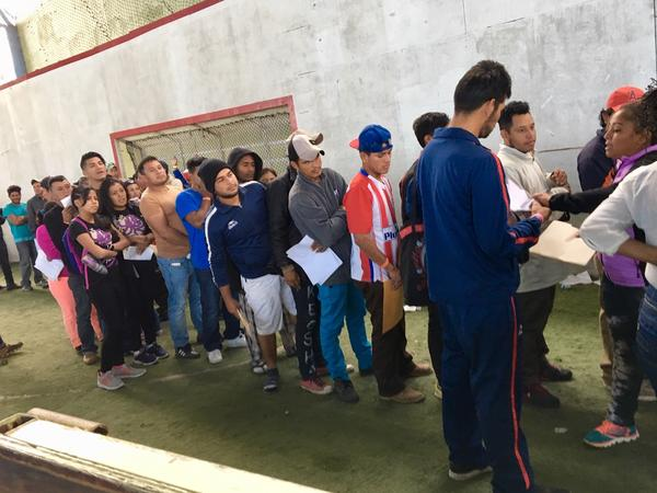 Central American migrants line up to apply for jobs at a job fair in Tijuana, Mexico. More than two thousand migrants have applied for a one-year humanitarian visa that would allow them to hold jobs legally in Mexico.