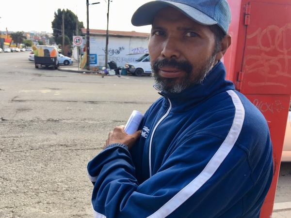 Honduran migrant Rene Castillo, with new working papers in hand. He is one of thousands of Central American migrants waiting in Tijuana to apply for asylum in the U.S.