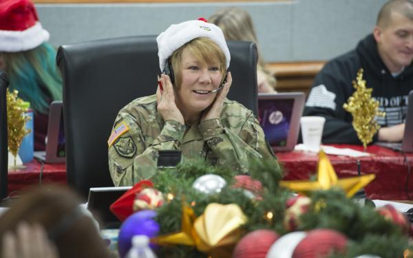 A volunteer answers phone calls on Dec. 24, 2016.