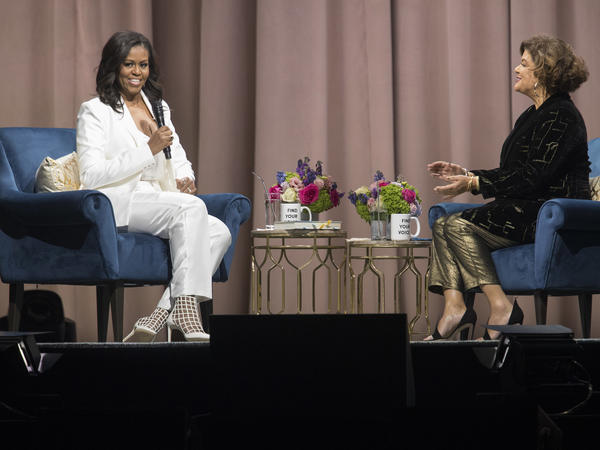 Michelle Obama (left) talks with poet Elizabeth Alexander during an event for the former first lady's memoir at Barclays Center in Brooklyn, N.Y., on Saturday.