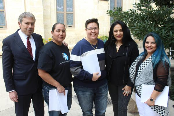 """Attorney Mike Ware, from left, stands with the """"San Antonio Four"""": Anna Vasquez, Kristie Mayhugh, Cassandra Rivera, and Elizabeth Ramirez, who had their criminal convictions expunged on Monday."""