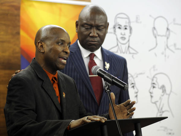 Emantic Bradford Sr. (left) discusses the results of a forensic examination on his son, EJ, who was fatally shot by police on Thanksgiving. Flanked by attorney Ben Crump, the elder Bradford addressed a news conference Monday in Birmingham, Ala.