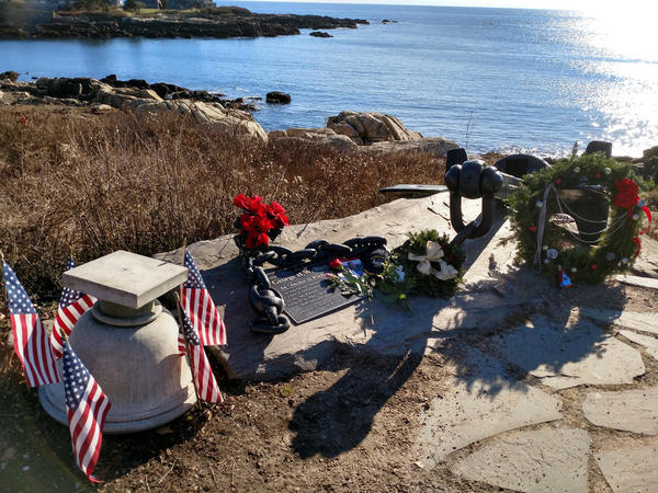 Flowers and wreaths adorn a naval anchor honoring President George H.W. Bush on a bluff overlooking Walker's Point in Kennebunkport, Maine on Saturday, Dec. 1, 2018.