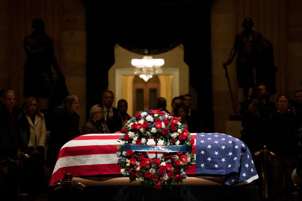 """Bush was eulogized during a Capitol ceremony by Senate Majority Leader Mitch McConnell, who called him """"a humble servant who loved his fellow citizens."""""""