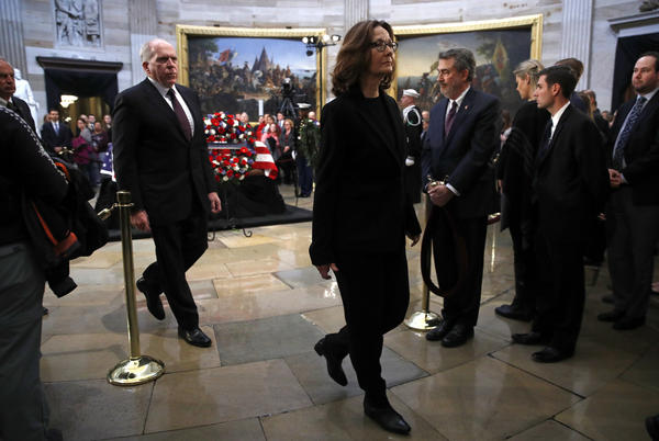 CIA Director Gina Haspel departs the Capitol Rotunda after visiting the flag-draped casket of former President George H.W. Bush as he lies in state in Washington.