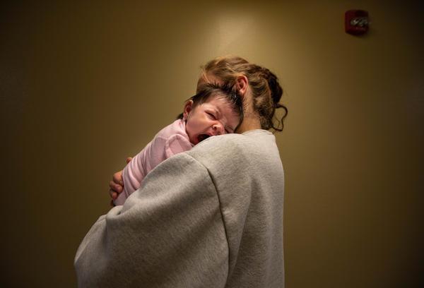 Cassandra Luthi holds her newborn daughter, Evelyn. She's part of the women's Residential Parenting Program.