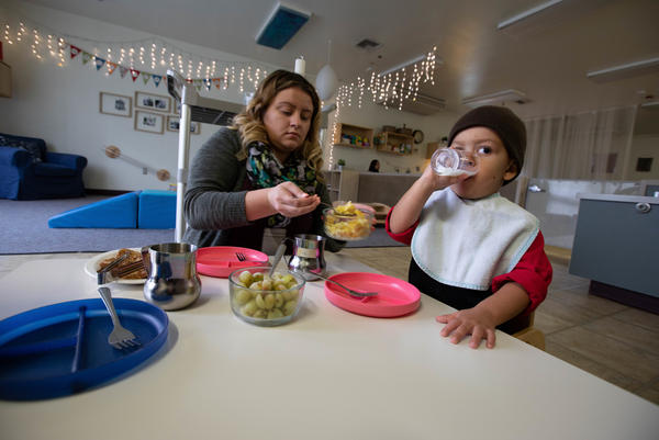 Kirshawn, 2, eats breakfast with his teacher at the in-prison daycare in Washington's correctional center.