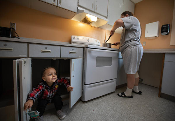 Crystal Lansdale cooks dinner for 2-year-old son, Kirshawn. Incarcerated mothers can purchase food and prepare meals for their kids. They receive state and federal assistance for low-income women, such as WIC (the nutrition program for Women, Infants and Children).