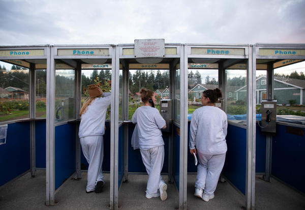 Inmates use pay phones at the Washington Corrections Center for Women. More than 1,000 are incarcerated in the overcrowded prison.