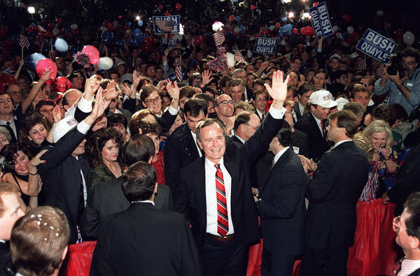 George Bush wades through a crowd in Houston after his victory speech in the 1988 presidential election.
