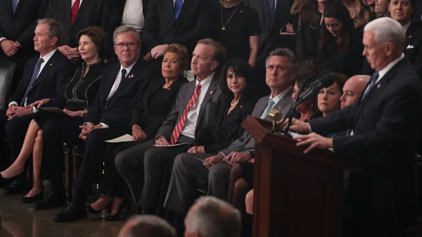 The Bush family listens to Vice President Pence speak during a U.S. Capitol ceremony honoring former President George H.W. Bush on Monday in Washington, D.C.