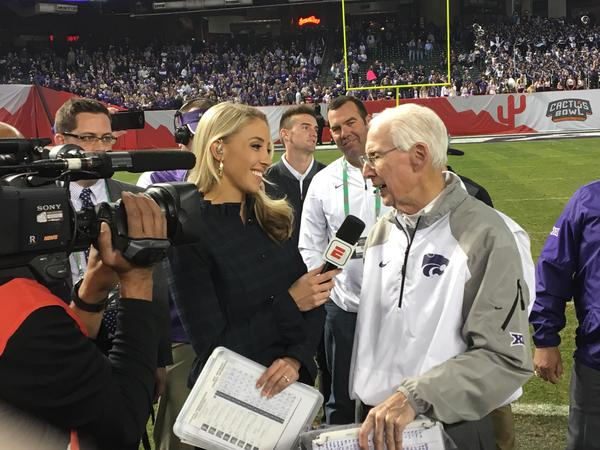 Kansas State football coach Bill Snyder is interviewed by ESPN's Olivia Harlan Dekker at the 2017 Cactus Bowl.