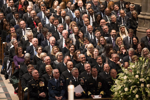 Dignitaries from around the world listen to former President George W. Bush eulogize his father.