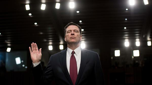 Ousted FBI Director James Comey is sworn in during a hearing before the Senate intelligence committee in June 2017. Comey had fought for an open hearing this month before the House Judiciary and Oversight committees.