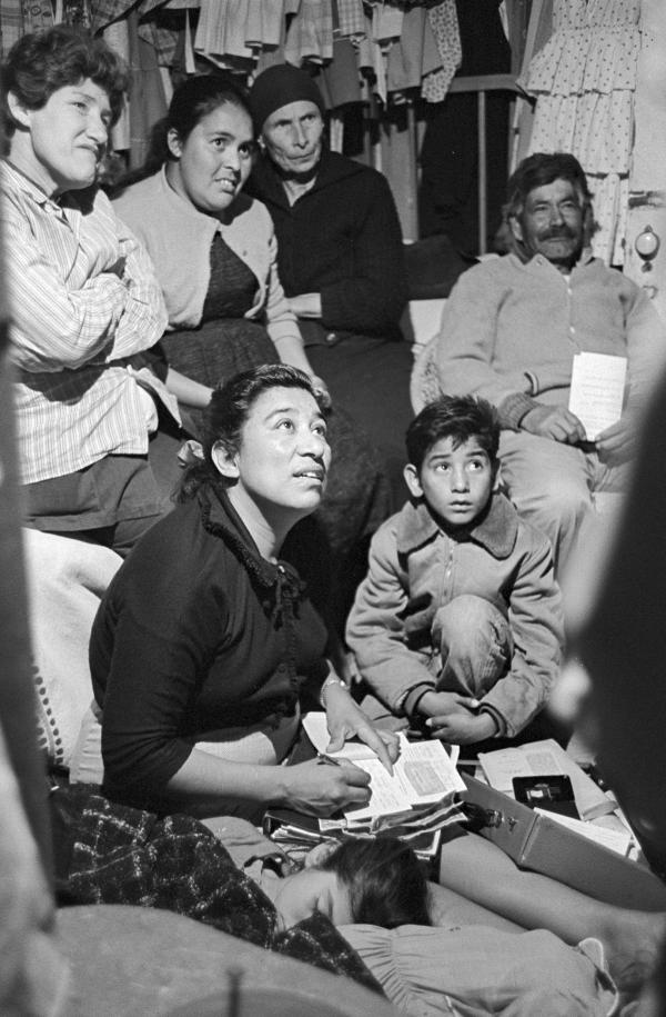 Maria Moreno, seated, taking notes.