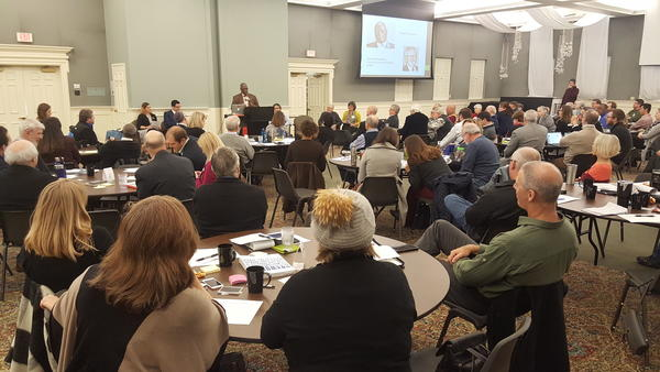 Kansas City Mayor Sly James talks about efforts to combat climate change at a workshop Dec. 8 in Prairie Village, Kansas. More than 100 local officials participated.