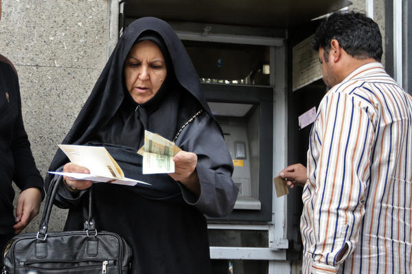 People withdraw money from a bank machine in the Iranian capital Tehran's Grand Bazaar in November, months after President Trump announced in May he was withdrawing from the 2015 Iran nuclear deal and reimposing sanctions on the country.