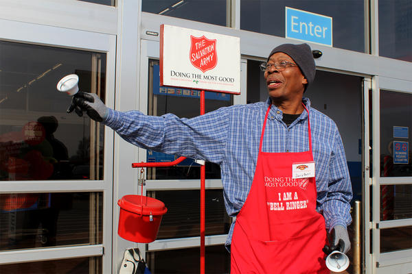 David Burks mans the Salvation Army's red kettle outside the Walmart store in Granite City.