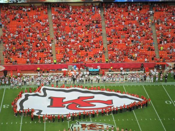 The Chiefs' logo on the field of a preseason game.