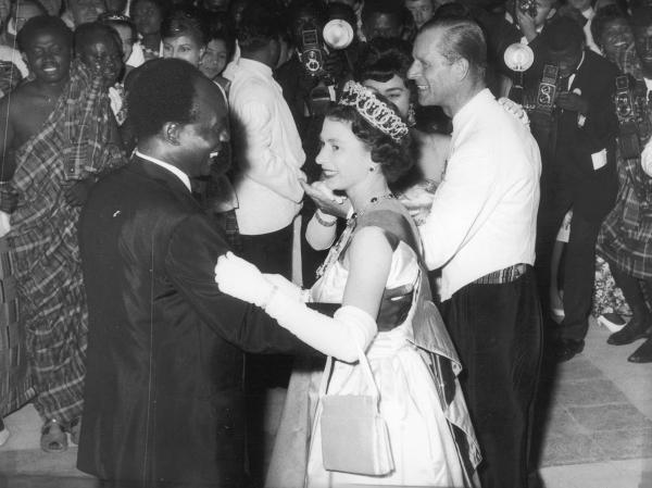 Queen Elizabeth II dances with Ghanaian President Kwame Nkrumah at a ball in Accra, Ghana, in 1961.