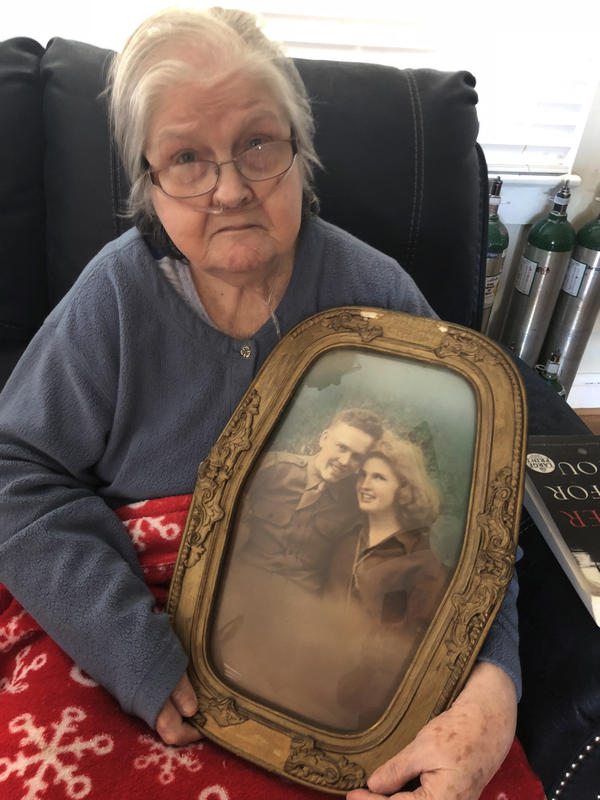 Christine Porter, 86, holds a portrait of her and her husband, Cpl. Kenneth F. Reese. He disappeared in North Korea just before Christmas 1950. Their daughter, Shelia Reese, was two months old when her father went missing.