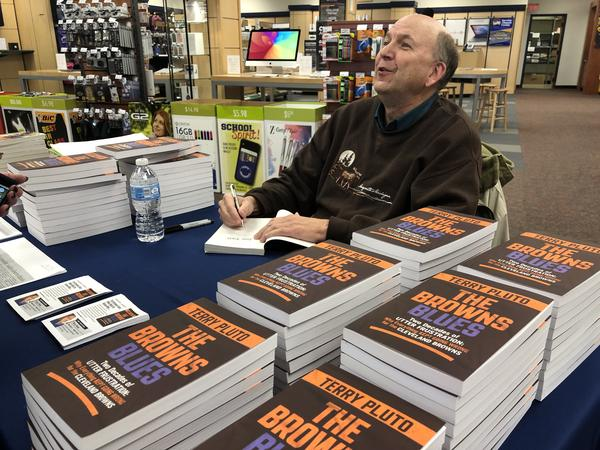 Terry Pluto signs copies of his new book at the Kent State bookstore.