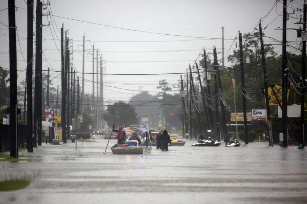 Rescue boats help evacuate residents in East Houston on Aug. 29, 2017, after Hurricane Harvey brought record flooding.