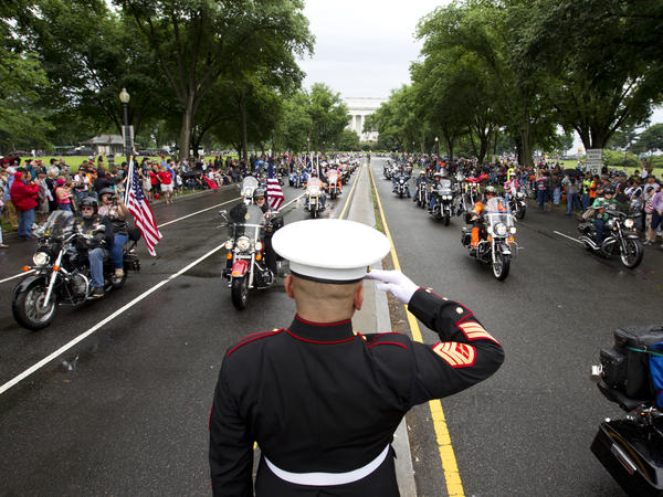 A U.S. Marine salutes as participants in the Rolling Thunder motorcycle rally rumble through Washington, D.C., in 2017. Organizers say the 2019 event will be the last in D.C.