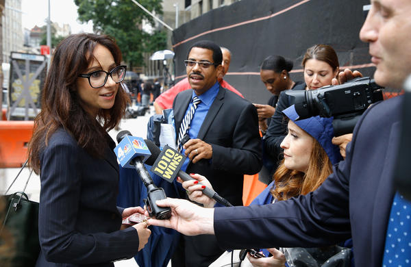 Attorney Carrie Goldberg speaks to the press as Weinstein leaves court after a criminal case hearing on Oct. 11 in New York City.